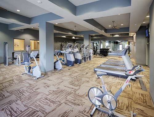 Large Fitness Center with cardio machines at LangTree Lake Norman Apartments, North Carolina