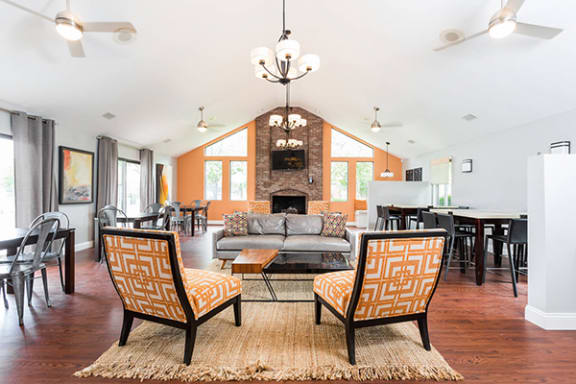 Spacious Clubhouse with Fireplace and TV Seating at Pheasant Run Apartments, Lafayette, Indiana