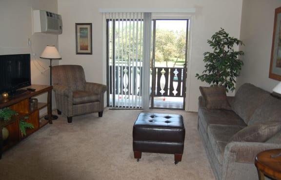 Spacious Living Room With Private Balcony at Briarwood Apartments, Benton Harbor, MI, 49022