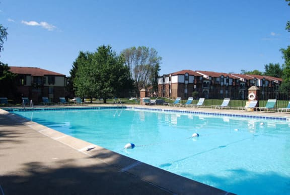Pool With Large Sundeck and Wi-Fi at Granada Apartments in Jackson, MI