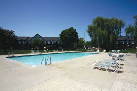 Refreshing Pool With Sundeck at Normandy Village Apartments in Michigan City, IN