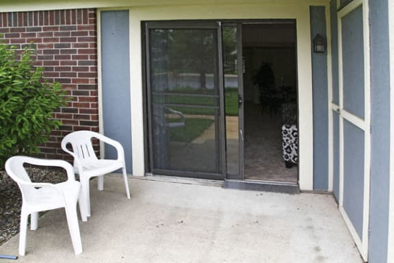 Patio Area with Storage at Pine Knoll Apartments in Battle Creek, MI