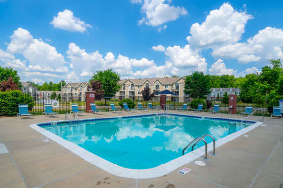 Poolside Lounge Chairs and Tables at Trillium Pointe Apartment Homes, Jackson 49201