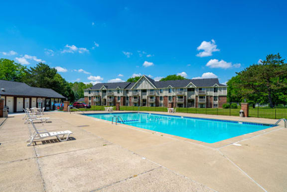 Refreshing Outdoor Pool with Large Sundeck at Waverly Park Apartments, Lansing, Michigan