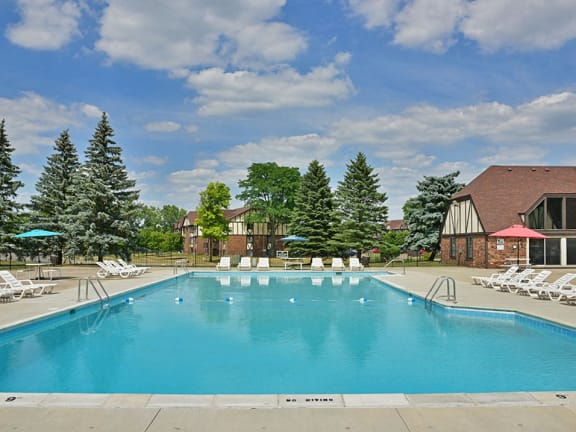 Large outdoor swimming pool and sundeck at Charter Oaks Apartments in Davison, MI