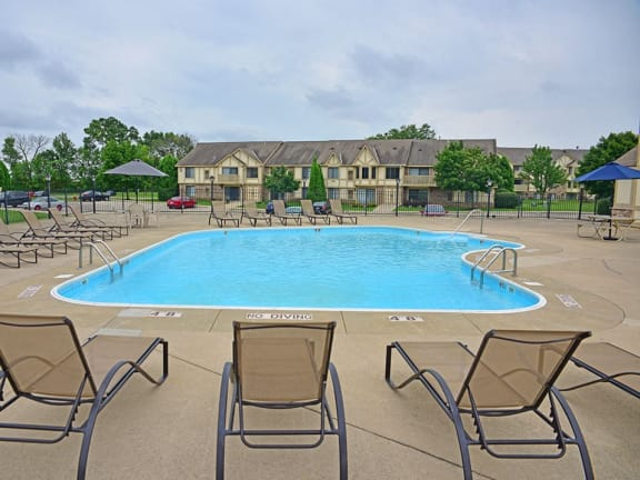 Outdoor pool with large sundeck at Tanglewood Apartments in Oak Creek, WI