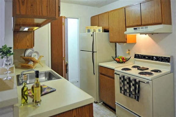 Well Equipped Kitchen with White Appliances at Brook Pines, SC