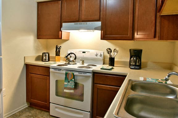 Well Equipped Kitchen with White Appliances at Prairie Lakes Apartments, Peoria