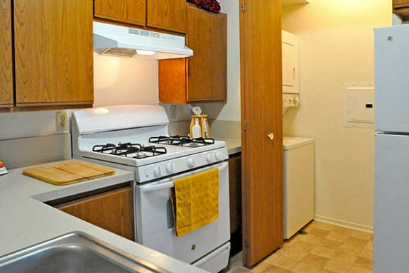 Kitchen with Washer and Dryer Nook at Southport Apartments, Belleville, MI