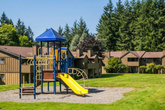 Children's Playground with Slides at Apartments Near Bremerton