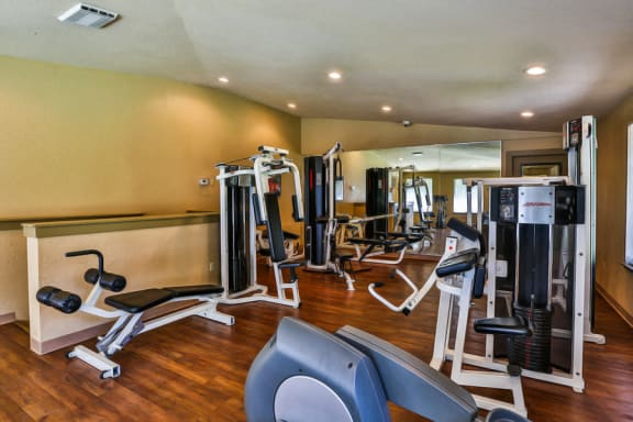 Resident Fitness Center with Exercise Machines at Apartments near Naval Base Kitsap