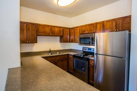 Spacious Kitchen with Quality Appliances at RidgeGate Apartments 85027