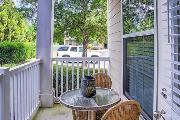 model deck with outdoor table and chair set at Centerville Manor Apartments, Virginia Beach, VA, 23464