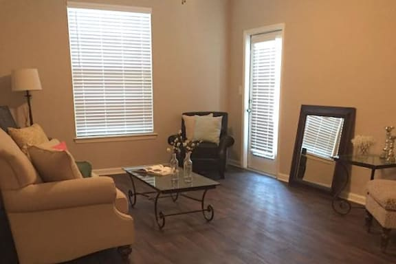 living room with furniture and venetian blinds at Centerville Manor Apartments, Virginia Beach