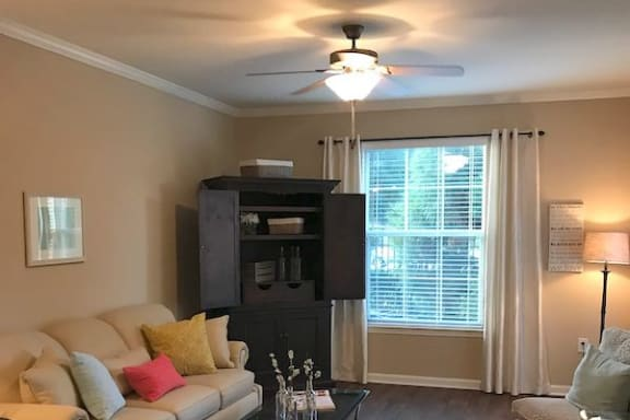 model living room with ceiling fan at Centerville Manor Apartments, Virginia Beach, 23464
