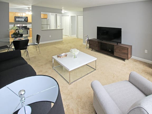 Upgraded Style Living Room with New Carpet, at Reserve Square in Cleveland, OH