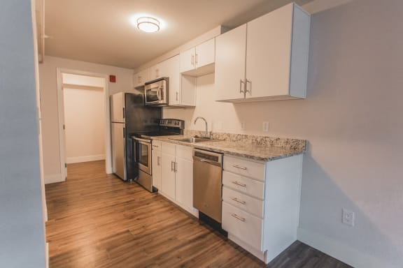 Kitchen With White Cabinetry And Appliances at -The Lodge-, Boulder