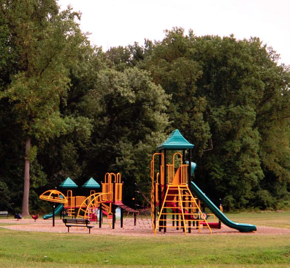 playground at Overlook apartments in Hyattsville MD with slide and various climbing structures over sand