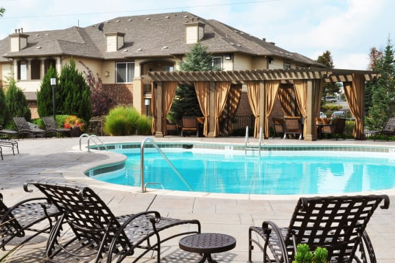 Resort-Style Swimming Pool with Lounge Seating at Best Apartments in Thornton CO