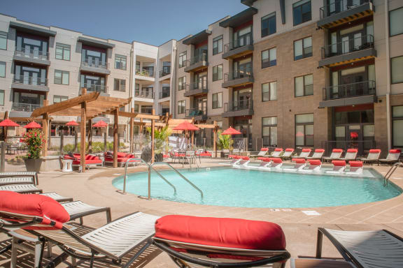 Swimming Pool with Lounge Seating at Avant Apartments, Carmel