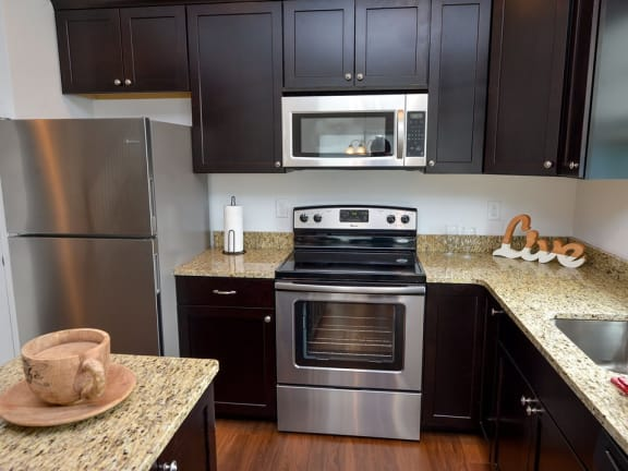 fully equipped kitchen with stainless steel appliances at Highland Village townhouses in Ross Township 15229