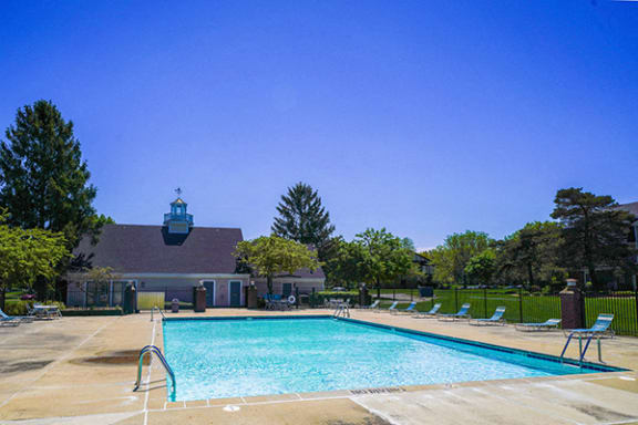 Refreshing Outdoors Swimming Pool with Sundeck at Walnut Trail Apartments, Portage, MI