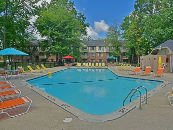 Swimming pool and sundeck at Woodland Place apartments in Midland, Michigan