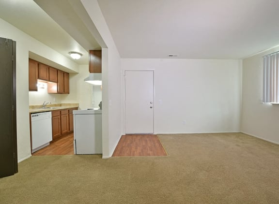 Carpeting in living room area at Perry Place Apartments in Grand Blanc, MI