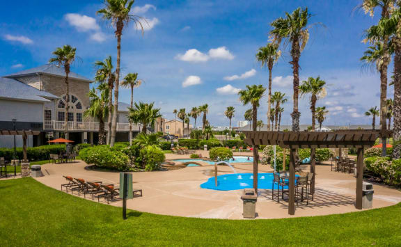 Resort Style Swimming Pool And Sundeck at The Club of the Isle, Galveston, TX