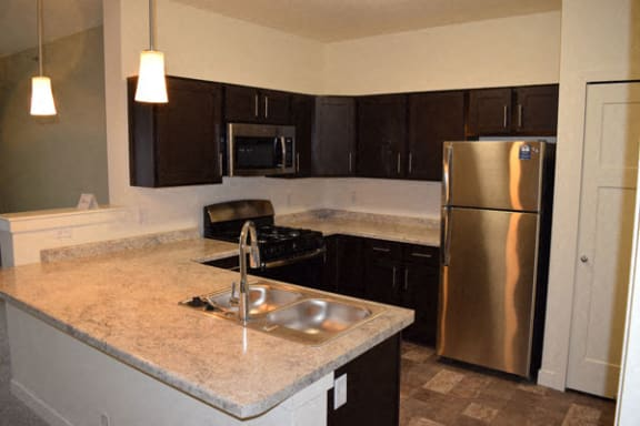 Stainless Steel Kitchen Appliances at The Reserve Apartment Homes in Grimes, Iowa
