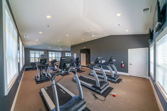 24-hour Fitness Center inside Community Building at The Reserve at Destination Pointe apartments, Grimes, IA 50111