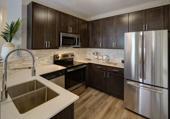 Gourmet Kitchens with Islands, Caesarstone Countertops, and Decorative Backsplash at City View at the Highlands, 2720 S Highland Ave, Lombard, IL 60148