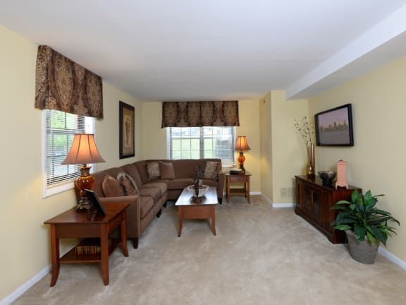 Plush, carpeted rooms at Chapel Valley Townhomes