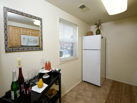 Bright, Eat-In Kitchen with Plenty of Cabinet Space at Colony Hill Apartments
