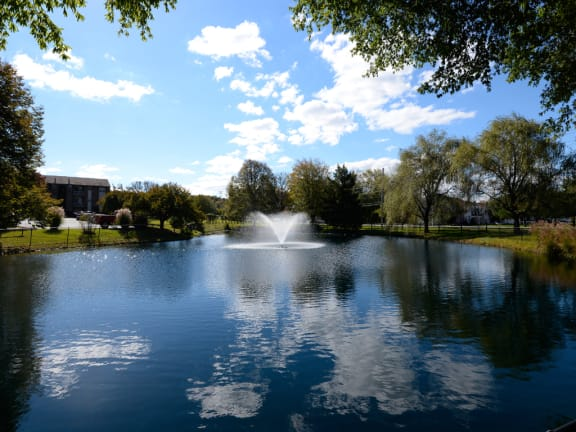 Beautiful Pond With Fountain at Woodsdale Apartments, Maryland