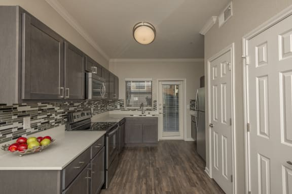 Spacious Kitchen with Pantry Cabinet at Marquette at Preston Park, 75093