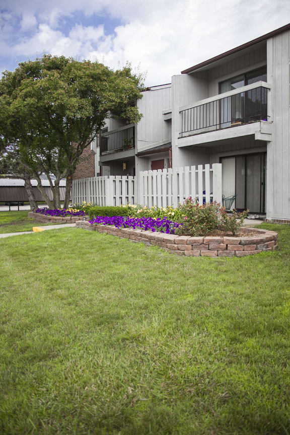 Courtyard and Building Exterior at Three Oaks Apartments in Michigan 48098