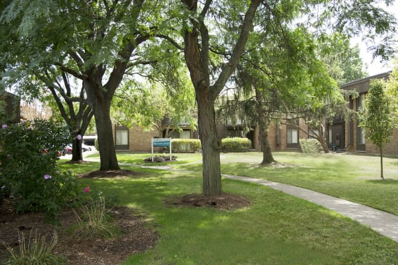 Courtyard with fresh manicured lawns at Westwood Village Apartments, Michigan 48185