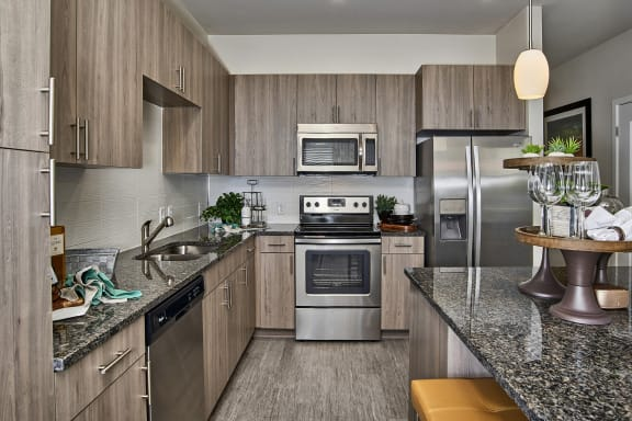 Enclave at Cherry Creek - Gray-toned wood cabinets with modern hardware