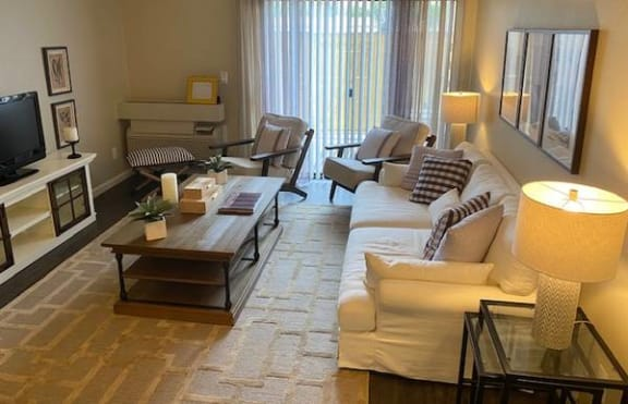 Living room with pation  Apts in North Hollywood CA 91605 | Canyon Village