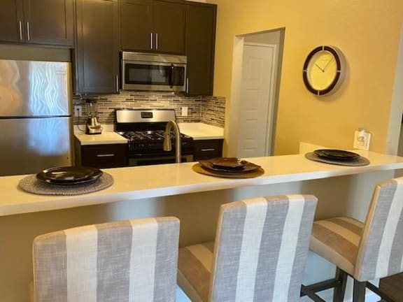 Kitchen with bar saeting  Apts in North Hollywood CA 91605 | Canyon Village