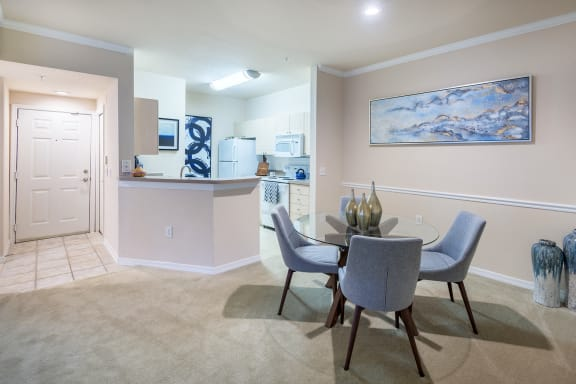 Versant Place Apartments breakfast bar in kitchen overlooking living room and dining room