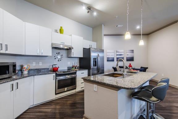 Centre Pointe Apartments granite countertops in kitchen and bath