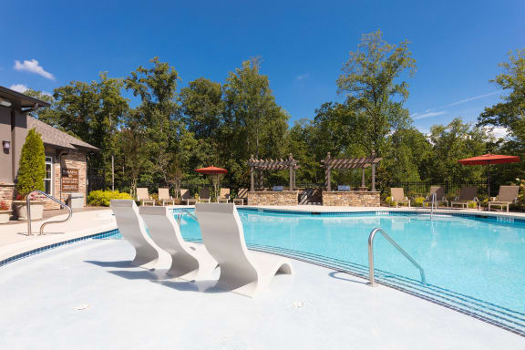 The Oaks at Johns Creek saltwater swimming pool with a sun ledge