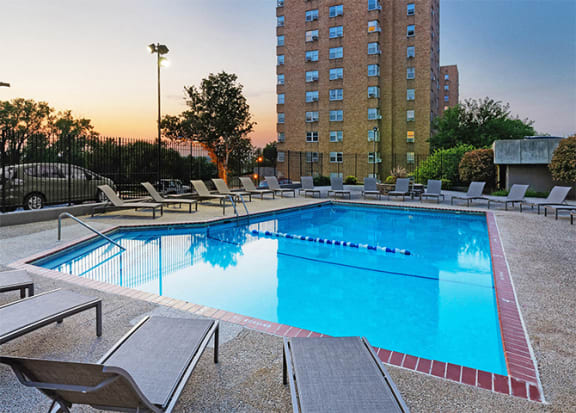 The KC High Line - Resort-style pool with surrounding sun deck and cabana