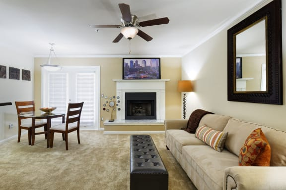 Brentwood Oaks Apartments - Staged living room with fireplace