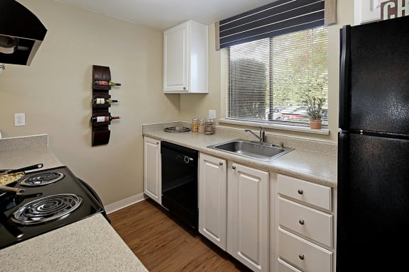 Kitchen with Stainless Steel Appliances and Refrigerator at Copper Ridge Apartments, Washington, 98055