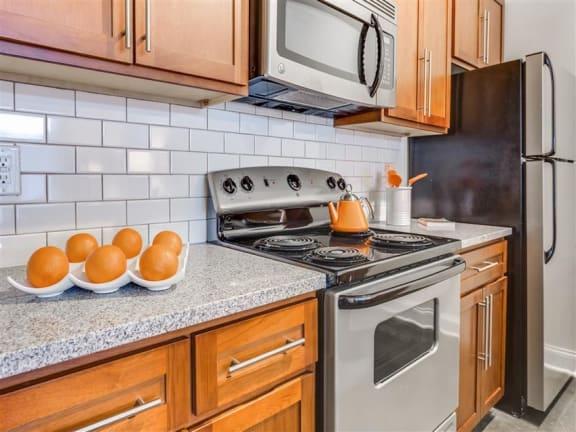 Electric Range In Kitchen at Greenway at Fisher Park, Greensboro, North Carolina