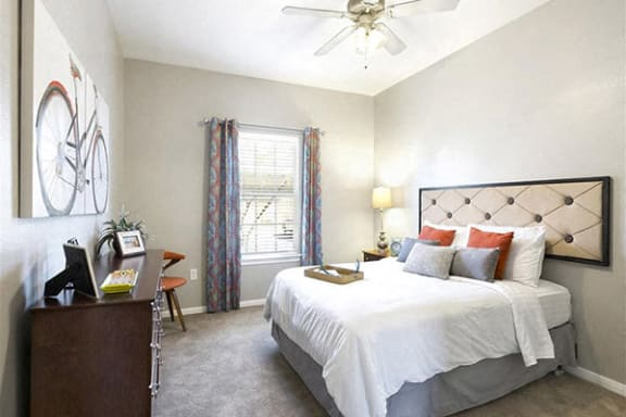 Spacious bedroom with ceiling fans