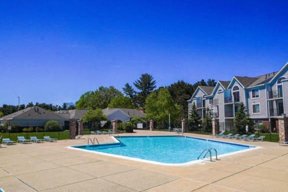 Refreshing Pool With Huge Sundeck at Gull Prairie/Gull Run Apartments and Townhomes in Kalamazoo, MI